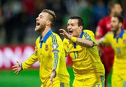 Andriy Yarmolenko (UKR) and Artem Fedetskiy (UKR) celebrate after scoring goal for Ukraine in last second during the UEFA EURO 2016 Play-off for Final Tournament, Second leg between Slovenia and Ukraine, on November 17, 2015 in Stadium Ljudski vrt, Maribor, Slovenia. Photo by Vid Ponikvar / Sportida