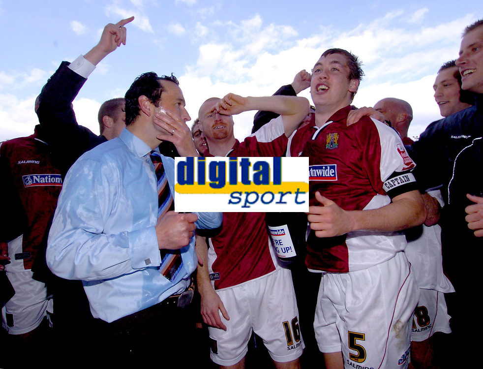 Photo: Ian Hebden.<br />Northampton Town v Chester City. Coca Cola League 2. 29/04/2006.<br />Northampton Town manager Colin Calderwood (L) and players Sean Dyche (C) and Luke Chambers (R) celebrate promotion.