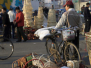 seller waiting for customers in old style outdoor market Beijing China