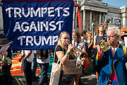 Trumpets for Trump as tens of thousands of protesters gather to march and demonstrate at the Together Against Trump national demonstration on 13th July 2018 in London, United Kingdom. Organisations The Stop Trump Coalition and Stand Up to Trump have come together for a one-off national demonstration to protest against President Trump's policies and politics during his official UK visit.