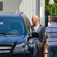 Actor Bruce Willis of USA is seen among members of the crew during the shooting of his next movie fifth in the Die Hard series titled Good Day to Die Hard in Budapest, Hungary on May 11, 2012. ATTILA VOLGYI