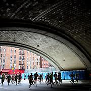 Runners make their way under the Queensboro Bridge along First Avenue in Manhattan, New York, during the ING New York Marathon. New York, USA. 3rd November 2013. Photo Tim Clayton
