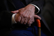 Dayton O. Hyde, 87, rests his hands on his cane during a special preview of Running Wild, a documentary on Hyde's life rescuing horses, at Big Dog Vineyards in Milpitas, California, on March 8, 2013. (Stan Olszewski/SOSKIphoto)
