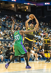 July 6, 2018 - Oakland, CA, U.S. - OAKLAND, CA - JULY 06: Metta World Peace (15) co-captain of the Killer 3s takes a jump shot over Reggie Evans (30) co-captain of 3 Headed Monsters during game 4 in week three of the BIG3 3-on-3 basketball league on Friday, July 6, 2018 at the Oracle Arena in Oakland, CA  (Photo by Douglas Stringer/Icon Sportswire) (Credit Image: © Douglas Stringer/Icon SMI via ZUMA Press)