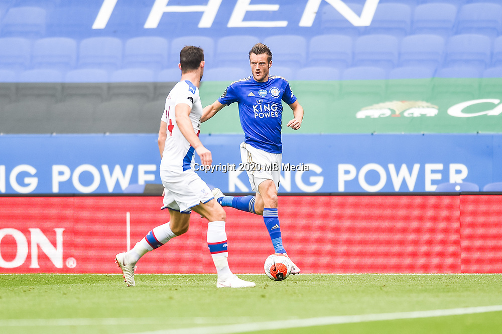 LEICESTER, ENGLAND - JULY 04: Jamie Vardy of Leicester City takes on Gary Cahill of Crystal Palace during the Premier League match between Leicester City and Crystal Palace at The King Power Stadium on July 4, 2020 in Leicester, United Kingdom. Football Stadiums around Europe remain empty due to the Coronavirus Pandemic as Government social distancing laws prohibit fans inside venues resulting in all fixtures being played behind closed doors. (Photo by MB Media)