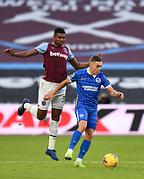 Football - 2020 / 2021 Premier League - West Ham United vs Brighton & Hove Albion - London Stadium<br /> <br /> Brighton & Hove Albion's Leandro Trossard holds off the challenge from West Ham United's Ben Johnson.<br /> <br /> COLORSPORT/ASHLEY WESTERN