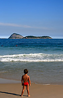 child looking at the sea and the surfer beautiful ipanema beach in rio de janeiro brazil