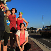 Bill Flythe, back-left, Lauren Abernathy, back-left center, Molly Adams, Tish Vincent, and trainer Sarah Barbee pose for a portrait in front of Omega Sports where they met each Wednesday to train for the Quintiles Wrightsville Beach Half Marathon.  (Jason A. Frizzelle)