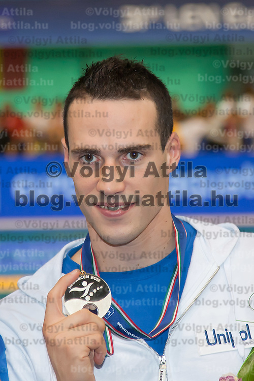 Fabio Scozoli of Italy celebrates his victory in the Men's 100m breaststroke during the 31th European Swimming Championships in Debrecen, Hungary on May 22, 2012. ATTILA VOLGYI