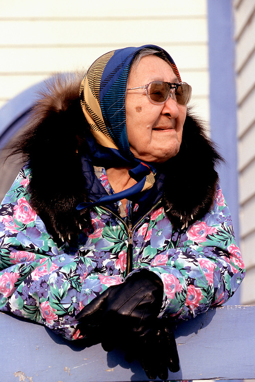 Amy Okpeaha stands outside the Presbiterian Church while waiting for the service in Iñupiaq to begin. The church is over a hundred years-old.<br /> <br /> May 18, 19:23