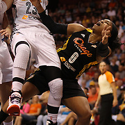 Odyssey Sims, (right), Tulsa Shock, is fouled while driving tot he basket by Katie Douglas, Connecticut Sun, during the Connecticut Sun Vs Tulsa Shock WNBA regular season game at Mohegan Sun Arena, Uncasville, Connecticut, USA. 3rd July 2014. Photo Tim Clayton