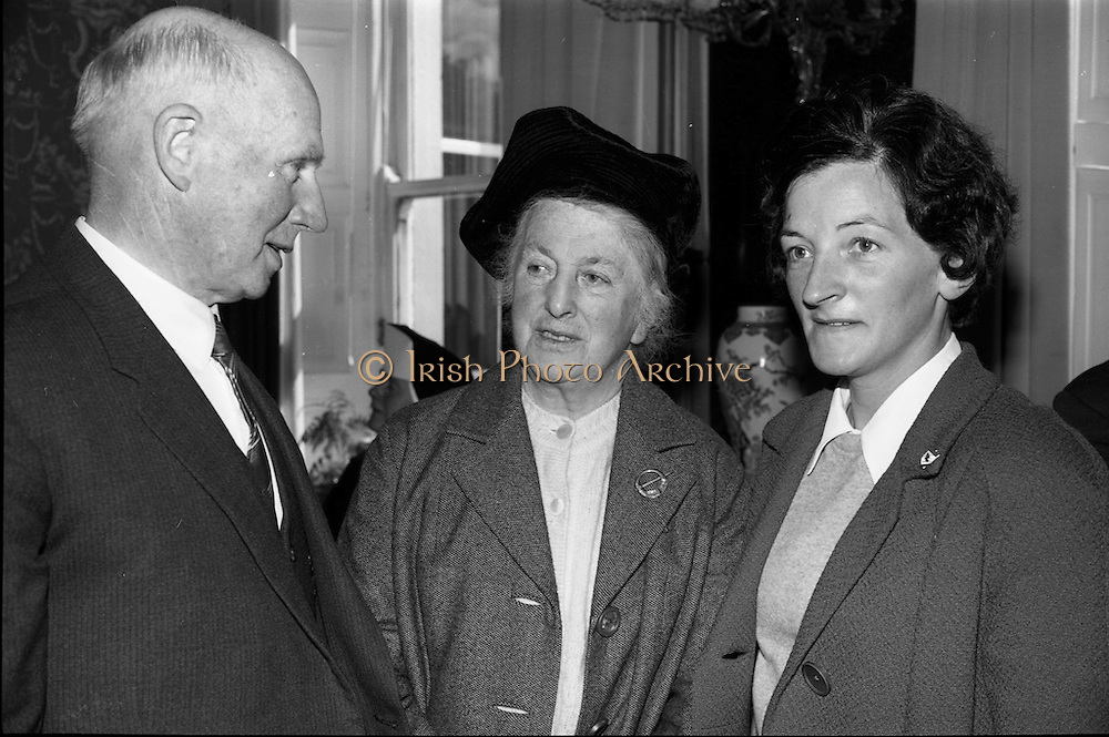 """23/05/1966<br /> 05/23/1966<br /> 23 May 1966<br /> 1916 Art prizes presented at Iveagh House. Prizes for literature, music and art offered by the 1916 Golden Jubilee Commemoration Committee were presented by the Minister for Education Mr. George Colley T.D. at a ceremony at Iveagh House, Dublin. Picture shows (l-r): Mr. Florence O'Donoghue, Loughlene, Eglantine Park, Douglas Road, Cork, who won a prize of £200 for his literary work """"The failure of the German Arms landing at Easter 1916 - a new interpretation"""" with Mrs Florence O'Donoghue and Miss B. McCoy, Douglas Road, Cork, after the ceremony."""