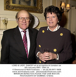 LORD & LADY  OAKSEY at a reception in London on 9th January 2001.OKH 16