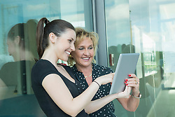 two female colleagues with tablet computer
