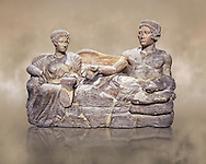 Etruscan cinerary, funreary, urn cover depicting a husband and wife,  from the Padata Necropolis, Chianciano, end of 5th century B.C., inv 94352 National Archaeological Museum Florence, Italy .<br /> <br /> If you prefer to buy from our ALAMY PHOTO LIBRARY  Collection visit : https://www.alamy.com/portfolio/paul-williams-funkystock - Scroll down and type - Etruscan Florence - into lower search box. (TIP - Refine search by adding a background colour as well).<br /> <br /> Visit our ETRUSCAN PHOTO COLLECTIONS for more photos to download or buy as wall art prints https://funkystock.photoshelter.com/gallery-collection/Pictures-Images-of-Etruscan-Historic-Sites-Art-Artefacts-Antiquities/C0000GgxRXWVMLyc