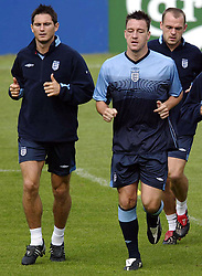 Frank Lampard and John Terry during an England training session in Manchester, ahead of the Euro 2004 qualifier against Macedonia in Skopje.  THIS PICTURE CAN ONLY BE USED WITHIN THE CONTEXT OF AN EDITORIAL FEATURE. NO WEBSITE/INTERNET USE UNLESS SITE IS REGISTERED WITH FOOTBALL ASSOCIATION PREMIER LEAGUE.