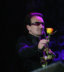 Andrea Corr and Bono perform on stage..50,000 people filed into Murrayfield Stadium in Edinburgh, Scotland, on Wednesday July 6, 2005. The free gig, labelled Edinburgh 50,000 - The Final Push was the last of Bob Geldof's momentous Live 8 concerts..Pic ©2010 Michael Schofield. All Rights Reserved.