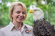 DAWN GRIFFARD OF WORLD BIRD SANCTUARY POSES WITH ANIMALS