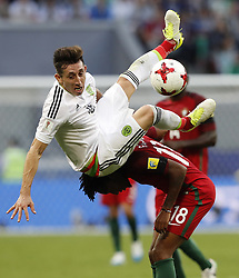 June 18, 2017 - Kazan, Russia - HECTOR HERRERA of Mexico is upended by GELSON MARTINS of Portugal during Confederations Cup action at Kazan Arena. (Credit Image: © Rodolfo Buhrer/Fotoarena via ZUMA Press)