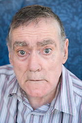 Portrait of a man with Alzheimer's Disease looking surprised,