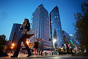 A woman walks through downtown Qingdao, Shandong Province, China on 23 August 2012. Qingdao is recognized as one of the most livable cities in China.