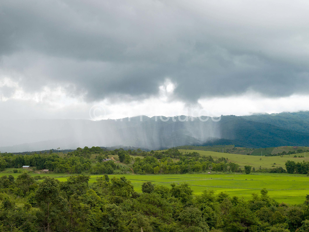 A view of the paddy fields and the rural landscape on the edge of Ban Namoune, Xieng Khouang Province, Lao PDR during the rainy season.