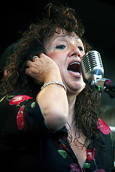 05 May 2012. New Orleans, Louisiana,  USA. .New Orleans Jazz and Heritage Festival. .Maria Muldaur, famous for her song 'Midnight at the Oasis' performs with the 'Preservation Hall and Friends' ensemble. .Photo; Charlie Varley.
