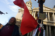 Red flag and anti-capitalist activist on the 11th day of the Occupy London protest camp in St Paul's cathedral churchyard, London 26/11/11. City lawyers are using medieval pedestrian bylaws to gain a court injunction to evict the activists who set up tents and shelters as in other countries.