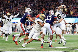 UCF Knights quarterback McKenzie Milton (10) runs for a touchdown during the 2018 Chick-fil-A Peach Bowl NCAA football game against the Auburn Tigers on Monday, January 1, 2018 in Atlanta. (Jason Parkhurst / Abell Images for the Chick-fil-A Peach Bowl)