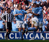 Photo. Glyn Thomas, Digitalsport<br /> NORWAY ONLY<br /> <br /> Manchester City v Newcastle United. <br /> FA Barclaycard Premiership. 01/05/2004.<br /> Man City's (R-L) Nicolas Anelka, Joey Barton and Paul Bosvelt celebrate Paul Wanchope winning goal as Newcastle's Gary Speed (L) looks on dejectedly.