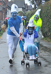 January 1, 2018 - Kent, Kent, UK -  SMURFS TEAM RACING..The traditional New Years day Sutton Valence Pram Race in Kent continued this year. In its 38th year the Race was struck by tragedy last year when competitor Francis 'Titch' O' Sullivan tipped over in his spitfire pram and hit his head on the curb, he passed away a day later. A coroners court reported he was not wearing a helmet.. All babies in the pram's have to wear a helmet and the pushers must have contact with the pram and the ground at all times. (Credit Image: © Grant Falvey/London News Pictures via ZUMA Wire)