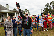 A home owner shows off his live chicken before throwing it to revelers in traditional costume during the Faquetigue Courir de Mardi Gras chicken run on Fat Tuesday February 17, 2015 in Eunice, Louisiana. The traditional Cajun Mardi Gras involves costumed revelers competing to catch a live chicken as they move from house to house throughout the rural community.
