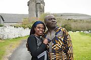 """18/04/2017 REPRO FREE:  <br /> Former Graduate Dr. Kizito Maria Kasule and his daughter MFA Graduate Joan Nanfuka who graduated from at the 13th conferring ceremony, held in the Minstrels gallery the 16th century Newtown Castle at the heart of the BCA campus, exemplifies the continued success of the Burren's  alternative model of art education . The Irish and  international graduates included Elizabeth Matthews, conferred with  a PhD for her research on Utopian studies , and six international graduates whose work on display in the BCA gallery addressed the ultimate question, """"who am I called to be"""" In her address President of the college Mary Hawkes Greene referred to the unique place based educational  model  committed to  individual student centred  education accredited by NUIGalway , and how it effectively  embraces the often conflicting forces of the global and the local, the public and the private as well as the collective and the individual. <br /> .  Photo:Andrew Downes, xposure"""