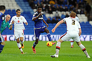 Cardiff City's Sammy Ameobi (c) takes on M K Dons captain Dean Lewington (3). Skybet football league championship match, Cardiff city v MK Dons at the Cardiff city stadium in Cardiff, South Wales on Saturday 6th February 2016.<br /> pic by Carl Robertson, Andrew Orchard sports photography.