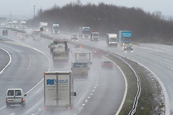 © Licensed to London News Pictures 20/01/2021. <br /> Swanley, UK. Dangerous wet driving for motorists on the M25 near Swanley in Kent today with rain water causing surface spray. The Prime Minister Boris Johnson is to chair a Cobra meeting this afternoon as storm Christoph hits the UK with heavy rain and high winds. Photo credit:Grant Falvey/LNP