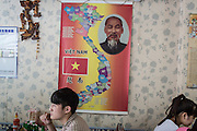 Customers pictured under a poster of Vietnam with Ho Chi Minh in one of the many Vietnamese restaurants located in Taoyuan. In many large city centers around Taiwan, clusters of Souteast Asian businesses have cropped up to cater to the large population of migrant workers on the island.