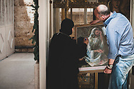 The nun in charge of the Greek Orthodox monastery of St. Thecla (Mar Takla), located in the small Syrian town of Maalula, one of the few Aramaic-speaking communities in the world, writes on a picture of Jesus.<br /> <br /> (June 10, 2010)