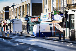 A forensics tent covers the spot where a 17 year-old boy died after being stabbed on Caledonian Road, Islington, North London. London, January 30 2019.