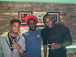 "Usain Bolt releases a photo on Instagram with the following caption: ""Respect to @chronixxmusic @leonbailey_9  for passing through the Grand Opening of @tracksrecordsuk  #TracksandRecordsParty #JamaicanVibes\ud83c\uddef\ud83c\uddf2"". Photo Credit: Instagram *** No USA Distribution *** For Editorial Use Only *** Not to be Published in Books or Photo Books ***  Please note: Fees charged by the agency are for the agency's services only, and do not, nor are they intended to, convey to the user any ownership of Copyright or License in the material. The agency does not claim any ownership including but not limited to Copyright or License in the attached material. By publishing this material you expressly agree to indemnify and to hold the agency and its directors, shareholders and employees harmless from any loss, claims, damages, demands, expenses (including legal fees), or any causes of action or allegation against the agency arising out of or connected in any way with publication of the material."