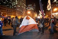 Boston, MA 12/09/2011.Occupy Boston protestors set up a tent in the middle of Atlantic Avenue early Friday morning..Alex Jones / www.alexjonesphoto.com