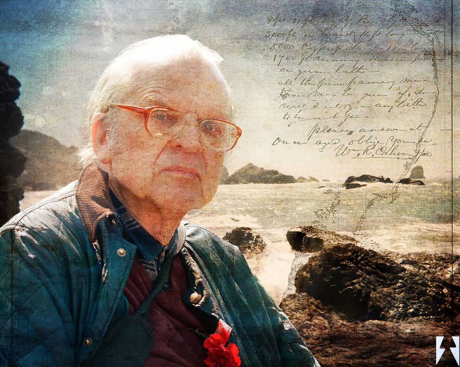 Old man sitting at the rocky coast of Seattle in the cold of winter.