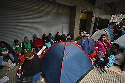 June 27, 2017 - Buenos Aires, Argentina - Activists from social organizations set up tents in front of the Argentine Ministry of Labour, Employment and Social Security as a part of protest demanding higher wages and decriminalization of social protests in Buenos Aires, Argentina. (Credit Image: © Anton Velikzhanin via ZUMA Wire)