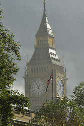 © Licensed to London News Pictures. 01/11/2012. Westminster, UK Sunlight bounces of Big Ben in London today, 1st November, as a rain shower hits Westminster. Photo credit : Stephen Simpson/LNP