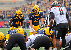 Nov 23, 2019; Morgantown, WV, USA; West Virginia Mountaineers quarterback Jarret Doege (2) pauses over center at the goal line during the second quarter against the Oklahoma State Cowboys at Mountaineer Field at Milan Puskar Stadium. Mandatory Credit: Ben Queen-USA TODAY Sports