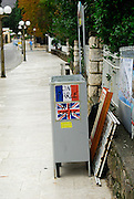 Bilingual sign (French and English) with flags, at tourist kiosk. Lapad, Dubrovnik, Croatia