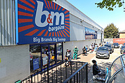 Customers queue outside the Old Kent Road branch of B & M on Tuesday afternoon, May 5, 2020 - following the social distance rules after the retailer reopened some of its retail stores across UK, amid the coronavirus lockdown. (Photo/Vudi Xhymshiti)