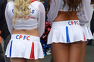 two Crystal Palace 'Crystals' Cheerleaders wait outside Selhurst Park to pose with fans before k/o. Barclays Premier League match, Crystal Palace v West Bromwich Albion at Selhurst Park in London on Saturday 3rd October 2015.<br /> pic by John Patrick Fletcher, Andrew Orchard sports photography.