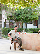 A man sits drinking tea in the early morning, in the Christian quarter of Damascus, Syria