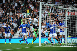 Derby County's Craig Bryson jumps over the ball as Derby County's Chris Martin scores a goal. - Photo mandatory by-line: Dougie Allward/JMP - Mobile: 07966 386802 30/08/2014 - SPORT - FOOTBALL - Derby - iPro Stadium - Derby County v Ipswich Town - Sky Bet Championship