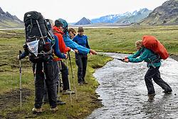 09-07-2014 ISL: Iceland Diabetes Challenge Dag 5, Emstrur<br /> Van Alftavatn naar Emstrur / Bas van de Goor helpt Debbie de Poorter bij de eerste waterdoorsteek van de dag.